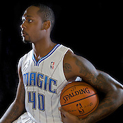 MIckell Gladness poses in front of a backdrop during the Orlando Magic media day event at the Amway Arena on Monday, September 30, 2103 in Orlando, Florida. (AP Photo/Alex Menendez)