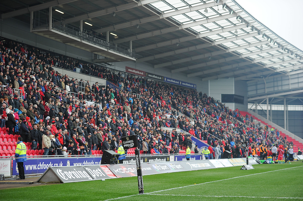 The crowd stands to pay respect for the minutes silence for Scarlets announcer Monro Walters<br /> <br /> Photographer Craig Thomas/CameraSport<br /> <br /> Rugby Union - Guinness PRO12 - Scarlets v Edinburgh - Saturday 28th March 2015 - Parc y Scarlets - Llanelli<br /> <br /> © CameraSport - 43 Linden Ave. Countesthorpe. Leicester. England. LE8 5PG - Tel: +44 (0) 116 277 4147 - admin@camerasport.com - www.camerasport.com