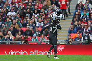 Houston Texan's wide receiver, Kenny Stills (12) catches the ball as he is tackled by Jacksonville Jaguars cornerback, Tre Herndon (37) during the NFL game between Houston Texans and Jacksonville Jaguars at Wembley Stadium in London, United Kingdom. 03 November 2019