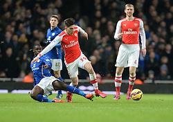 Leicester City's Jeffrey Schlupp tackles Arsenal's Hector Bellerin - Photo mandatory by-line: Alex James/JMP - Mobile: 07966 386802 - 10/02/2015 - SPORT - Football - London - Emirates Stadium - Arsenal v Leicester City - Barclays Premier League