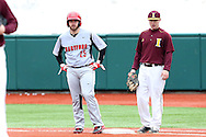21 February 2015: Hartford's Billy Walker (25) is held on first base by Iona's Jimmy Guiliano (right). The Iona College Gaels played the University of Hartford Hawks in an NCAA Division I Men's baseball game at Jack Coombs Field in Durham, North Carolina as part of the Duke Baseball Classic. Hartford won the game 12-1.