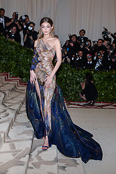 Gigi Hadid walking the red carpet at The Metropolitan Museum of Art Costume Institute Benefit celebrating the opening of Heavenly Bodies : Fashion and the Catholic Imagination held at The Metropolitan Museum of Art  in New York, NY, on May 7, 2018. (Photo by Anthony Behar/Sipa USA)