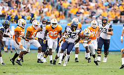 Sep 1, 2018; Charlotte, NC, USA; West Virginia Mountaineers running back Martell Pettaway (32) runs the ball during the third quarter against the Tennessee Volunteers at Bank of America Stadium. Mandatory Credit: Ben Queen-USA TODAY Sports