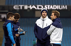 """Tottenham Hotspur's Eric Dier (centre) and Christian Eriksen (right) check out the pitch before the Premier League match at the Etihad Stadium, Manchester. PRESS ASSOCIATION Photo. Picture date: Saturday December 16, 2017. See PA story SOCCER Man City. Photo credit should read: Martin Rickett/PA Wire. RESTRICTIONS: EDITORIAL USE ONLY No use with unauthorised audio, video, data, fixture lists, club/league logos or """"live"""" services. Online in-match use limited to 75 images, no video emulation. No use in betting, games or single club/league/player publications."""
