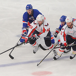 May 12, 2012: Washington Capitals defenseman Mike Green (52), right wing Mike Knuble (22), New York Rangers center Derek Stepan (21) and right wing Ryan Callahan (24) race for a loose puck during second period action in game 7 of the NHL Eastern Conference Semi-finals between the Washington Capitals and New York Rangers at Madison Square Garden in New York, N.Y.
