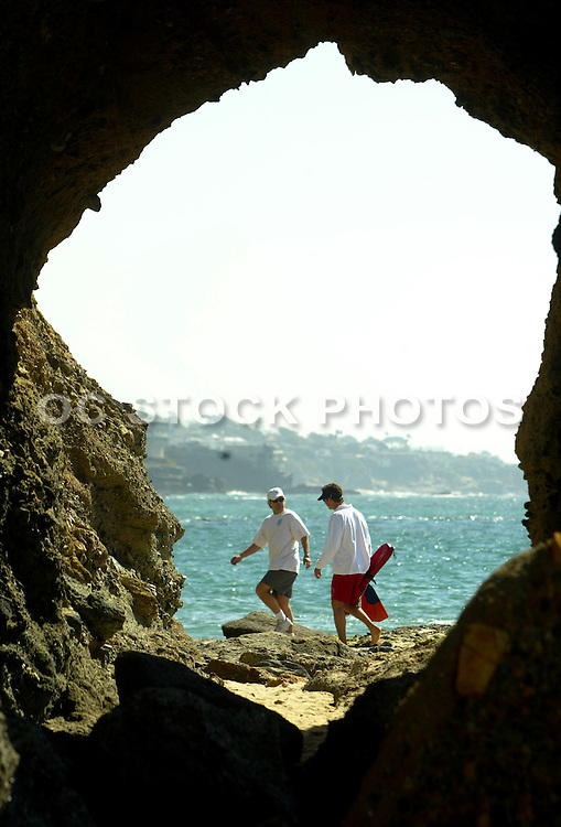 Lifeguard Walking Over Rocks In Laguna Beach