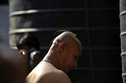 April 4, 2017 - Kathmandu, Nepal - Priests taking holy bath before carrying idol Seto Machindranath towards chariot for the annual festival of Seto Machindranath Chariot festival at Kathmandu, Nepal on Tuesday, April 04, 2017. Devotees celebrates weeklong festival of idol Seto Machindranath for timely rainfall and good harvest. (Credit Image: © Narayan Maharjan/Pacific Press via ZUMA Wire)