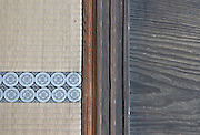 Koto-In Buddhist temple, detail of tatami mat and sh?ji (paper) screen runners. The edge of the tatami mat is finished with linen bearing a 'Kourai Beri' design (Korean pattern). In polite society the edging was not walked on when moving around the room. Kyoto, Japan, 2004