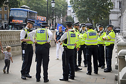© Licensed to London News Pictures. 31/08/2019. London, UK. Large police numbers near 10 Downing Street in Westminster, central London to demonstrate as part of a nationwide 'Stop The Coup' day of action against Boris Johnson's plans to suspend parliament. More than 80 demonstrations are planned across the UK in response to government plans to prorogue parliament. Photo credit: Ben Cawthra/LNP