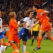 NLD/Amsterdam/20051112 - Voetbal, vriendschappelijke wedstrijd Nederland - Italie, Fabio Cannavaro (5), Dirk Kuyt (9), Alberto Gilardino (11), Ron Vlaar (3)
