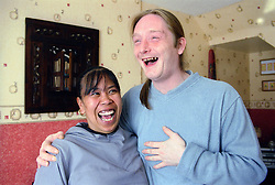 Couple standing together laughing,