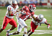 Sep 10, 2011; Little Rock, AR, USA; Arkansas Razorback running back Jarius Wright (4) carries the ball as New Mexico Lobos linebacker Joe Stoner (39) looks on and defensive back Destry Berry (24) attempts the tackle during the first half at War Memorial Stadium.  Mandatory Credit: Beth Hall-US PRESSWIRE