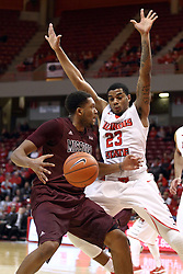 28 January 2015:   Gavin Thurman temporarily looses the ball as he drives in against Deontae Hawkins during an NCAA MVC (Missouri Valley Conference) men's basketball game between the Missouri State Bears and the Illinois State Redbirds at Redbird Arena in Normal Illinois