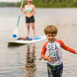 A boy plays in the water in Second Roach Pond near the Appalachian Mountain Club's Medawisla Lodge in the Maine Woods near Greenville.