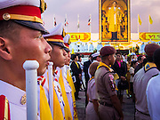 Thai military cadets stand in formation in front of the stage with a large portrait of the King at his birthday celebration. Thais observed the 86th birthday of Bhumibol Adulyadej, the King of Thailand, their revered King on Thursday. They held candlelight services throughout the country. The political protests that have gripped Bangkok were on hold for the day, although protestors did hold their own observances of the holiday. Thousands of people attended the government celebration of the day on Sanam Luang, the large public space next to the Grand Palace in Bangkok.