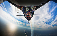 JON M. FLETCHER / The Times-Union -- 110509 -- Aerobatic pilot Lt. Col. John Klatt from Minneapolis, Minnesota, goes inverted in his Extra 300L over Jacksonville Beach Thursday, November 5, 2009.  Klatt, who represents the Air National Guard, will be one of several aerial performers at the Jacksonville Sea and Sky Spectacular airshow this weekend.  (Jon M. Fletcher, The Florida Times-Union)