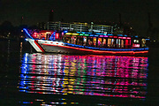 """Sumida River Dinner Cruise on a Yakatabune traditional Heian Period Japanese boat, in Tokyo, Japan. Depart from Harumi Asashio Small Craft pier on Harumi Island, at Reimei Bashi Bridge, 5-min walk from Kachidoki Station of Oedo line. Harumiya company's """"Odaiba & Skytree route"""". Seating is at horigotatsu low table with a sunken floor to comfortably stretch your legs. Rainbow Bridge has an arching suspension designed named for its shape (and changing night-time illuminations also resemble a rainbow)."""