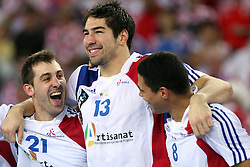Team of France (Michael Guigou (21), Nikola Karabatic (13)  and Daniel Narcisse (8) of France) celebrates after the 21st Men's World Handball Championship 2009 Gold medal match between National teams of France and Croatia, on February 1, 2009, in Arena Zagreb, Zagreb, Croatia. France won 24:19 and became World Champion 2009.  (Photo by Vid Ponikvar / Sportida)