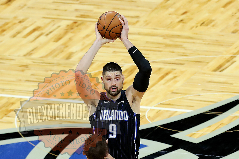 ORLANDO, FL - MARCH 03: Nikola Vucevic #9 of the Orlando Magic controls the ball against the Atlanta Hawks at Amway Center on March 3, 2021 in Orlando, Florida. NOTE TO USER: User expressly acknowledges and agrees that, by downloading and or using this photograph, User is consenting to the terms and conditions of the Getty Images License Agreement. (Photo by Alex Menendez/Getty Images)*** Local Caption *** Nikola Vucevic