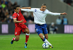 06.09.2011, Wembley Stadium, London, GBR, UEFA EURO 2012, Qualifikation, England vs Wales, im Bild Wales' Neil Taylor and England's Chris Smalling during the UEFA Euro 2012 Qualifying Group G match at Wembley Stadium on 6/9/2011. EXPA Pictures © 2011, PhotoCredit: EXPA/ Propaganda Photo/ Chris Brunskill +++++ ATTENTION - OUT OF ENGLAND/GBR+++++