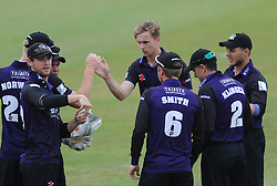 Craig Miles of Gloucestershire celebrates with his team mates after Geraint Jones of Gloucestershire catches out Daniel Bell-Drummond of Kent - Photo mandatory by-line: Dougie Allward/JMP - Mobile: 07966 386802 - 12/07/2015 - SPORT - Cricket - Cheltenham - Cheltenham College - Natwest Blast T20