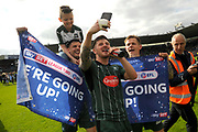 Matthew Kennedy (16) of Plymouth Argyle celebrates with a selfie and a lap of the pitch with Gary Miller (2) of Plymouth Argyle and Craig Tanner (27) of Plymouth Argyle  at full time promotion to League 1 after a 6-1 win during the EFL Sky Bet League 2 match between Plymouth Argyle and Newport County at Home Park, Plymouth, England on 17 April 2017. Photo by Graham Hunt.