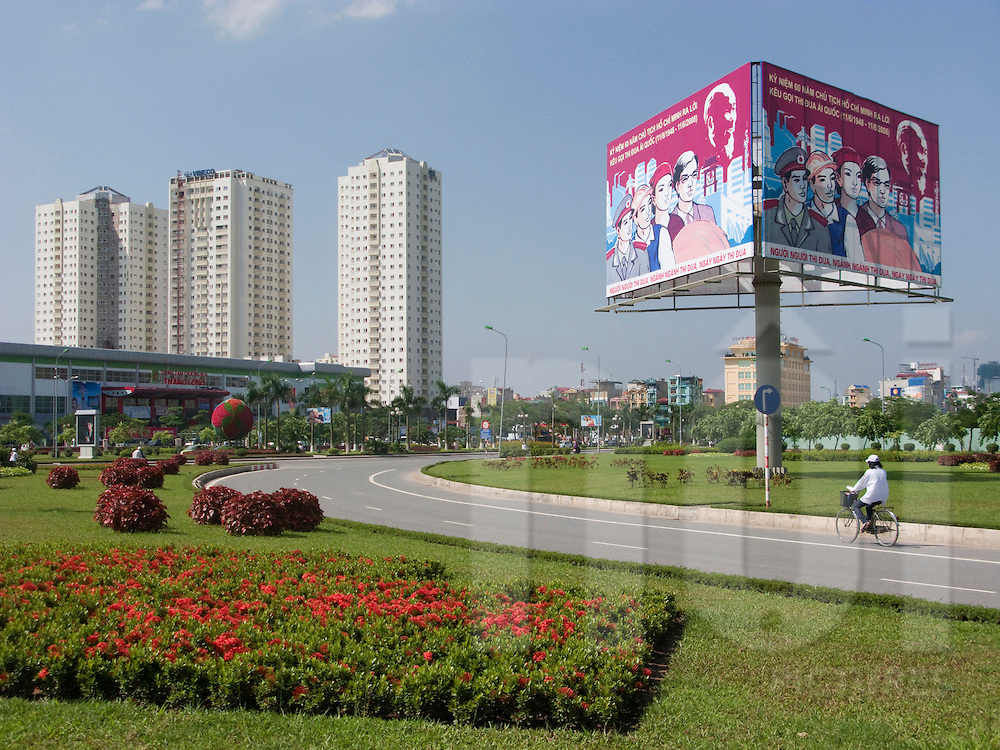 Cross road between Pham Hung street and Tran Duy Hung street, Cau Giay district, Hanoi. Propaganda billboard.