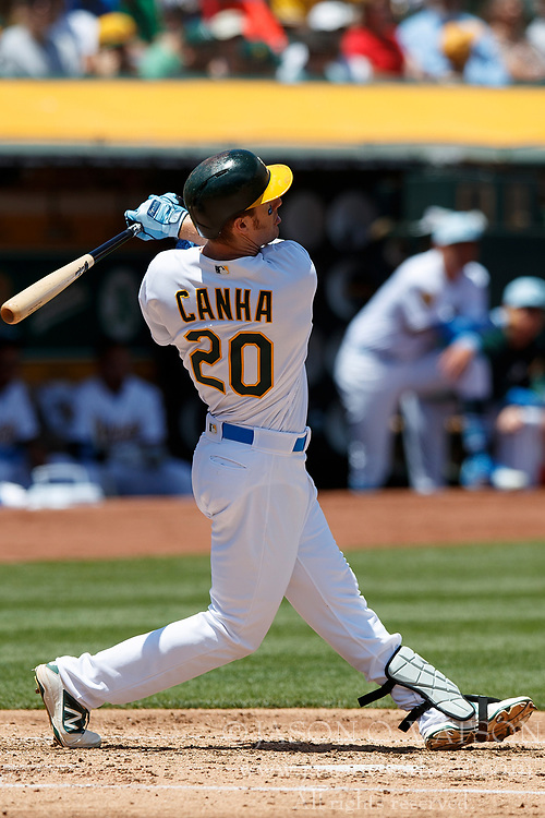 OAKLAND, CA - JUNE 17: Mark Canha #20 of the Oakland Athletics hits a home run against the Los Angeles Angels of Anaheim during the second inning at the Oakland Coliseum on June 17, 2018 in Oakland, California. The Oakland Athletics defeated the Los Angeles Angels of Anaheim 6-5 in 11 innings. (Photo by Jason O. Watson/Getty Images) *** Local Caption *** Mark Canha
