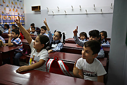 Mohammed Haitham Obeidi, 7, attends an English language class during his first day of school in Amman, Jordan, Aug. 20, 2007. His family fled Iraq after threats were made on his father's life. They are now awaiting asylum.