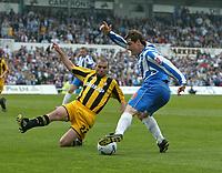 Photo: Andrew Unwin.<br />Hartlepool United v Port Vale. Coca Cola League 1. 06/05/2006.<br />Port Vale's Mark McGregor (L) looks to stop Hartlepool's Joel Porter.