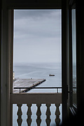 View of commercial harbor seen from hotel window, Trieste, Italy