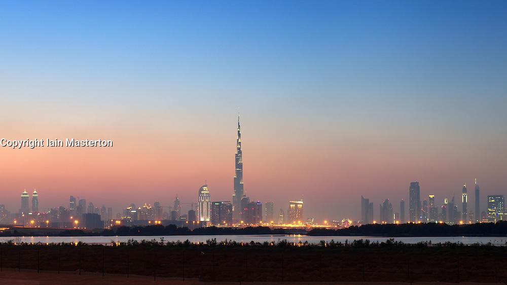Evening view of Burj Khalifa tower and skyline of Dubai United Arab Emirates
