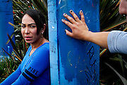 Valerie, left, and Flora, right, both transgendered migrant workers, in a parking lot where many migrant workers get picked up for work in Salinas, California, on Thursday, May 26, 2016.  <br /> Sarah Rice<br /> <br /> **Editor's note - Valerie and Flora are the pseudonyms the subjects told me the reporter was going to use