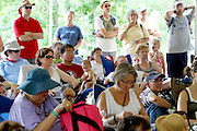 Festival attendees listen to Phyllis Tickle speak at the Wild Goose Festival at Shakori Hills in North Carolina June 24, 2011.  (Photo by Courtney Perry)