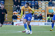 Tyler Walker of Mansfield Town (19) threads a pass forward during the The FA Cup match between Mansfield Town and Charlton Athletic at the One Call Stadium, Mansfield, England on 11 November 2018.