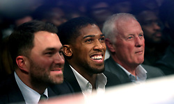 Eddie Hearn, Anthony Joshua and Barry Hearn in the audience at The O2 Arena, London.