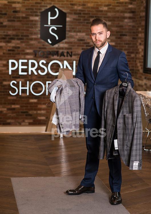 Daniel Rhone personal shopper at Top Man.<br /> Picture by Daniel Hambury/Stella Pictures Ltd +44 7813 022858<br /> 10/07/2014