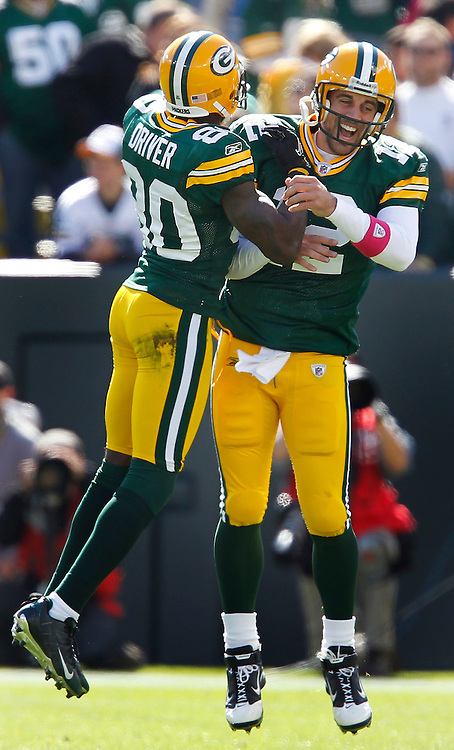 Green Bay Packers wide receiver Donald Driver and Aaron Rodgers celebrate a touchdown.