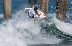 July 31, 2018 - Huntington Beach, California, United States - Huntington Beach, CA - Tuesday July 31, 2018: Flavio Nakagima in action during a World Surf League (WSL) Qualifying Series (QS) Men's round of 96 heat at the 2018 Vans U.S. Open of Surfing on South side of the Huntington Beach pier. (Credit Image: © Michael Janosz/ISIPhotos via ZUMA Wire)