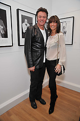 PAUL & STACEY YOUNG at a private view of photographs by Marina Cicogna from her book Scritti e Scatti held at the Little Black Gallery, 3A Park Walk London SW10 on 16th October 2009.