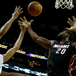 Oct 23, 2013; New Orleans, LA, USA; Miami Heat center Greg Oden (20) and New Orleans Pelicans power forward Anthony Davis (23) battle for a rebound during the first half of a preseason game at New Orleans Arena. Mandatory Credit: Derick E. Hingle-USA TODAY Sports