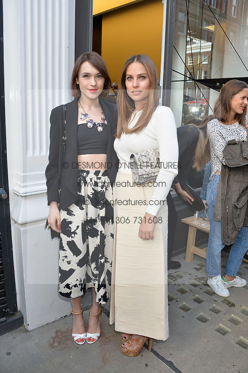 Left to right, ANNA LAUB founder of Prism and ELLA CATLIFF at the Prism Boutique Summer Party held at Prism, 54 Chiltern Street, London on 14th May 2014.