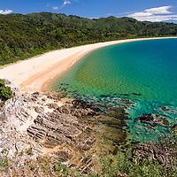 Totaraunui Bay is located in Abel Tasman National Park. Totaraunui Bay is 1km long and known for the orange-coloured sandy beach.