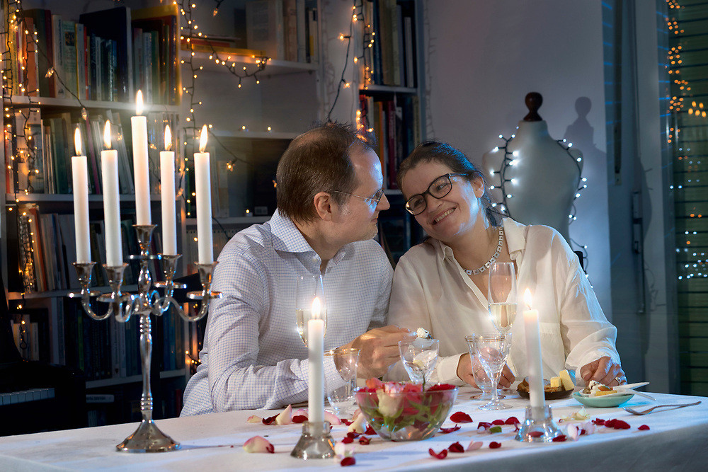 Romantic couple enjoying a candlelight dinner