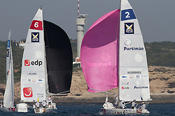Ian Williams leads Eugeny Neugodnikov into the bottom mark on day 1 of Portimao Portugal Match Cup 2010. World match Racing Tour. Portimao, Portugal. 23 June 2010. Photo: Gareth Cooke/Subzero Images