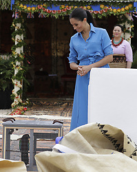 The Duchess of Sussex looks at a parrot in a cage during a visit to dedicate a forest reserve to the Queen's Commonwealth Canopy, at Tupou College on the second day of the royal couple's visit to Tonga.