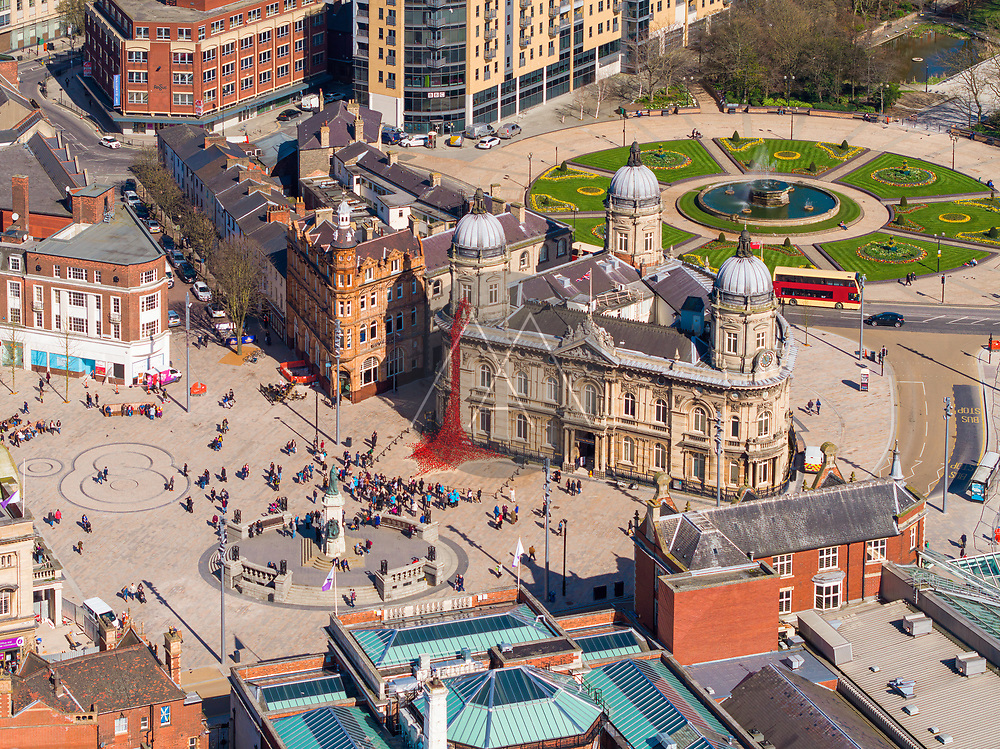 Aerial view of people standing in front of the city hall in Hull, United Kingdom.