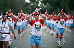 02 March 2014. New Orleans, Louisiana.<br /> Mardi Gras. Men with the all male dance group the 610 Stompers at the Krewe of Thoth parade in Uptown New Orleans.<br /> Photo; Charlie Varley/varleypix.com