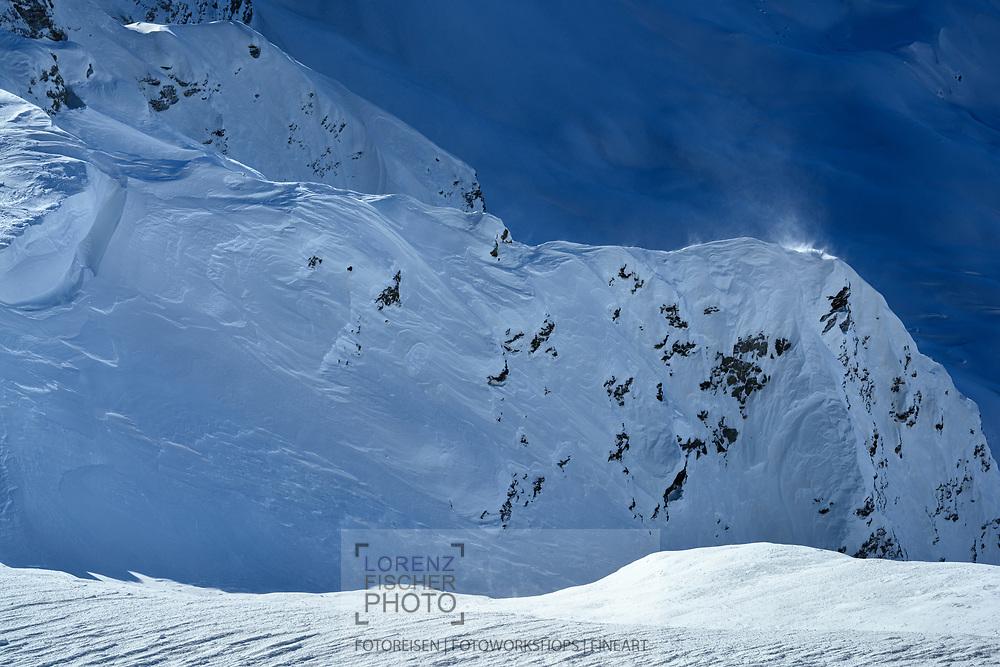 Winddrift on a ridge from a heavy foehn storm on the top of Piz d'Emmat Dadaint, Julier Pass, Grisons, Switzerland