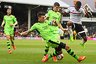 Danny Batth of Wolverhampton Wanderers makes a tackle on Floyd Ayite during the Sky Bet Championship match at Craven Cottage, London<br /> Picture by Richard Brooks/Focus Images Ltd 07947656233<br /> 18/03/2017